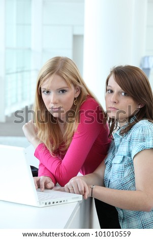 Two teenage girls with laptop computer