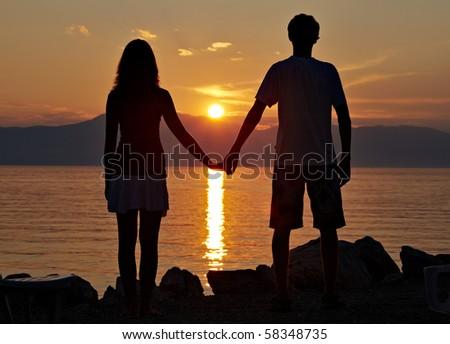 Two teenagers on the beach III