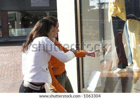 Two teenagers window shopping in town