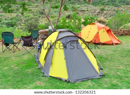 Two tents and chairs on camping site. Shot in Gifberg Mountains, near Wanrhynsdorp, Western Cape, South Africa.