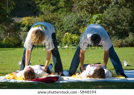 Two therapists massaging the runner after jogging