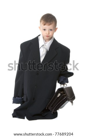Two, three years old baby boy businessman in big suit holding case  isolated on a white background