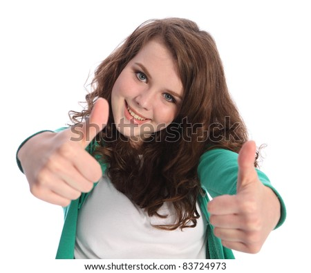 Two thumbs up hand sign for success by happy pretty teenager school girl with long brown hair. Girl has blue eyes and a big beautiful smile. - stock photo