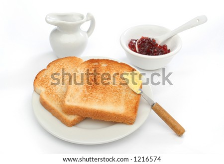 Two toast on a plate with butter on a knife and red jam behind. Deliciuos food for breakfast.  Look at my gallery for more meals