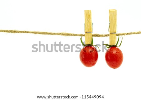 Two tomato hanging on clothespin,concept