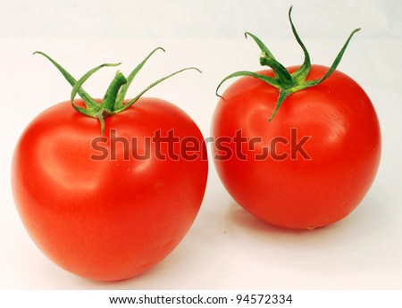 two tomatoes on the white background