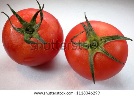 Stock Photo two tomatos on white background