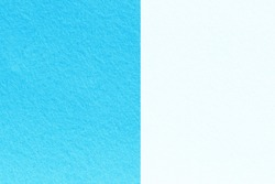 Two tone background of felt fabric texture background in blue and white colors with copy space.