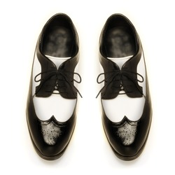 Two-tone black and white patent leather mens shoes on white
