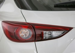 Two tone car tail lights are white and red.