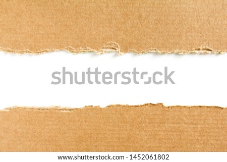 Two torn pieces of brown cardboard on white background with space for text. #1452061802