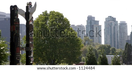 Two totem poles overlooking Vancouver, Canada.