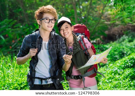Two tourists finding the route with navigator