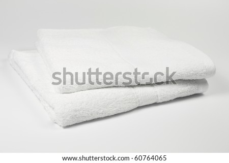 Two towels on simple white background.