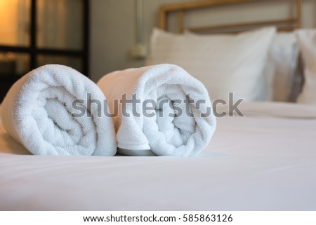 Two towels on the bed in hotel room #585863126