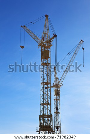 Two tower cranes on the skyline
