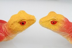 two toy lizards heads