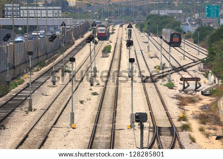 Two trains on the tracks at a railway junction in the center of Tel Aviv, Israel.