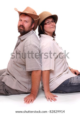 Two travelers in safari suit resting on a white background.