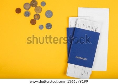 Two travelers passports with boarding passes for the plane on yellow background. Top view. Flat lay. #1366579199
