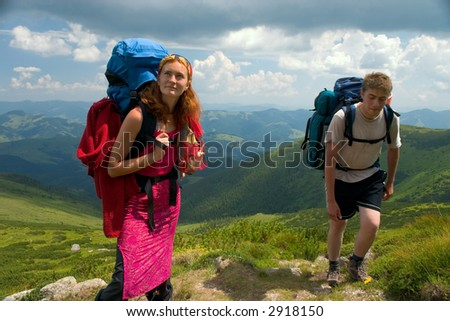 Two travellers with backpack hiking in the Carpathian mountains - stock photo