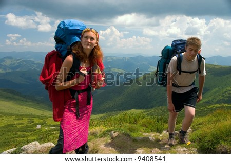 Two travellers with backpack hiking in the Carpathian mountains