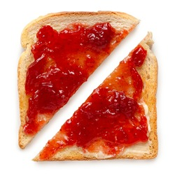 Two triangles of white toast spread with butter and strawberry jam isolated on white. Top view.