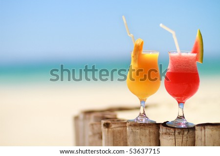Two tropical fresh juices on tropical beach