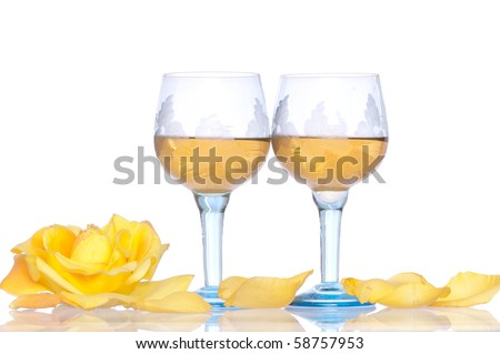 two tumblers with white wine and yellow rose on the party #58757953