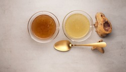 Two types of bone broth in glass bowls. Top view, copy space. Beef bones are a source of natural collagen, which is useful for joints and provides the body with essential amino acids.