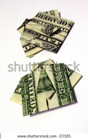 Two United States Dollar Bills Folded Origami Style Into A Shirt And