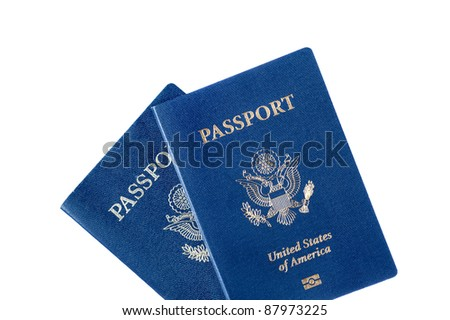 Two United States passports isolated on white.