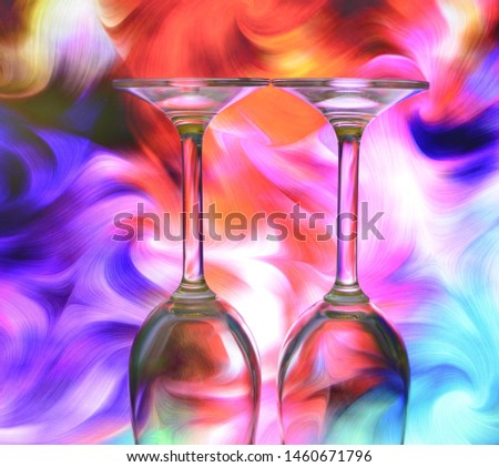 Two upturned glasses on a creative background, red, purple, turquoise