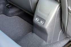 Two USB ports for the rear seats in a passenger car