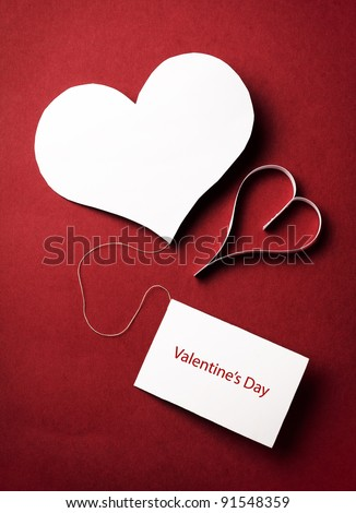 two valentine's paper hearts with a blank business card on a red background , valentine's day , day valentine , postcard