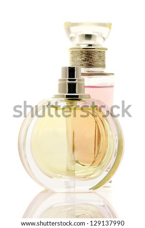 Two various female perfumes isolated on white background. - stock photo