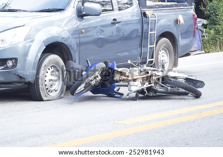 Two vehicle head-on accident, caused by one pickup blow out to yield, results in a motorcycle crash. #252981943
