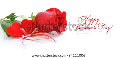 Two velvet hearts are with a red rose on a white background