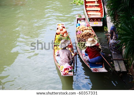 Two vendors on Damnoen Saduak Floating Market near Bangkok in Thailand