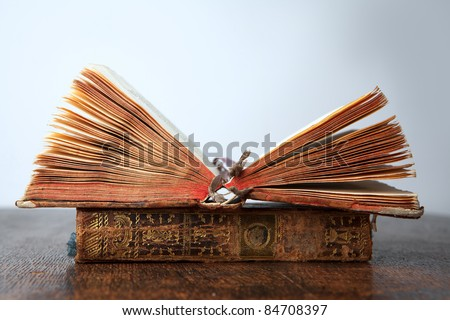 two very old books lying on old wooden table - shallow depth of field