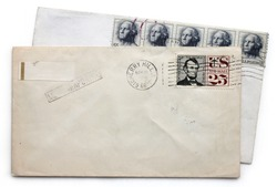 Two vintage airmail envelopes with Abraham Lincoln and George Washington postage stamps from USA.