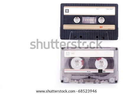 two vintage cassette tapes in black and transparent isolated on white and with copy space