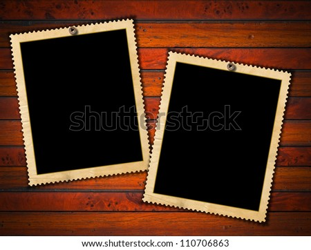 Two Vintage Photo Frames / Aged photo frames on wood background with ragged edge