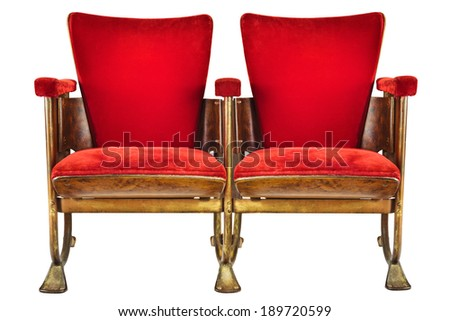 Two vintage red movie theater chairs isolated on a white background #189720599