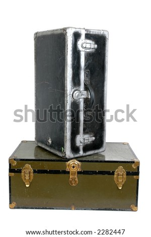Two vintage steamer trunks against white background