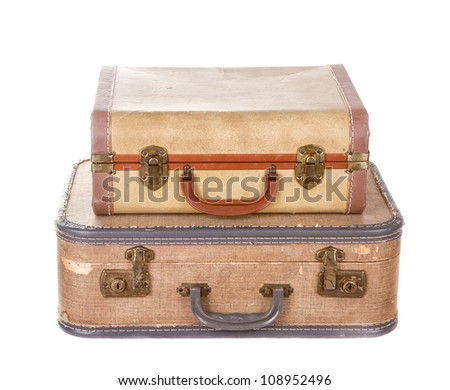 two vintage suitcases stacked isolated on white