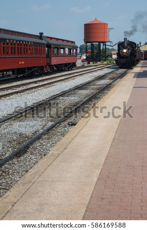 two vintage trains passing a...