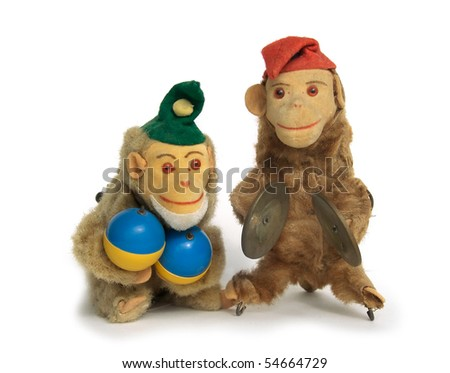 Two vintage wind-up monkey toys with maracas and cymbals