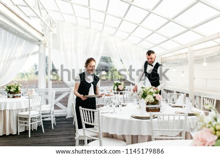 Two waiters serve at the restaurant #1145179886