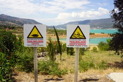 Two Warning Signs Both in Turkish and in English by Arapapisti Canyon.